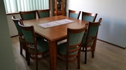 Square wooden dining table with 8 matching chairs. Hardly used.